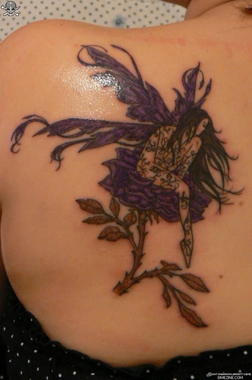 Sex Girl Showing Design Purple Fairy Tattoo On The Upper Back Body