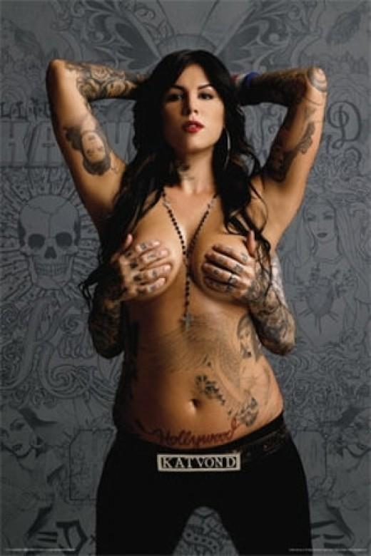 Woman sexy Kat Von D Breast Tattoo