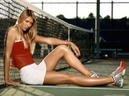 Maria Sharapova reclines on the tennis court in a small red top and ashort white skirt