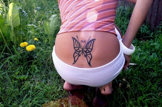 Lower Back Body Girls With One Triball Butterfly Tattoo Designs