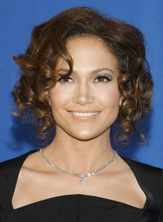 Ear level short curly haircuts for women with round faces