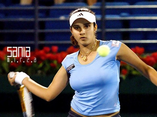 sania mirza hot wallpaper with gorgeous boobs waving with the ball