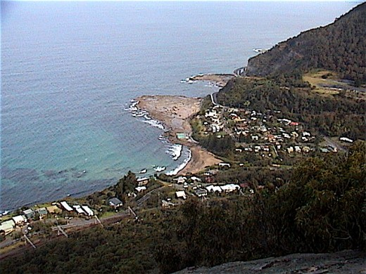 COALCLIFF village. Nestled on the northern Illawarra coast, just south of Stanwell Park and at the base of the Illawarra Escarpment. A large coal mine is located here in the back part of the valley where coal was first discovered in Australia.