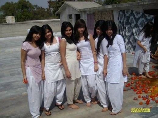 Wet and Sexy Desi girls celebrating Holi