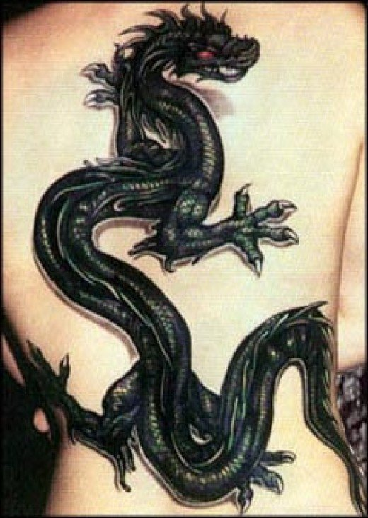 tribal dragon tattoos arm. Black tribal dragon tattoos