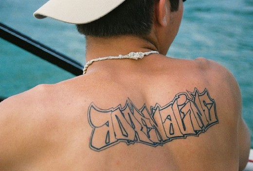 "simple nice male upper back tattoo. simple character tattoo ""Adrenaline"""