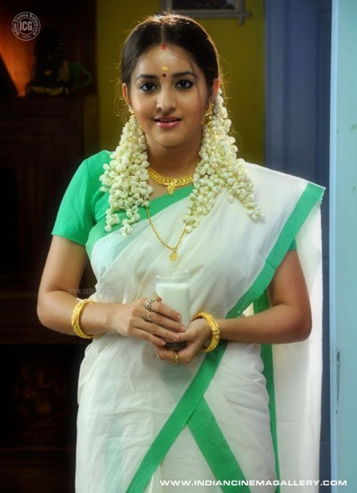 bhama in green bordered set saree with milk in hand for first night scene