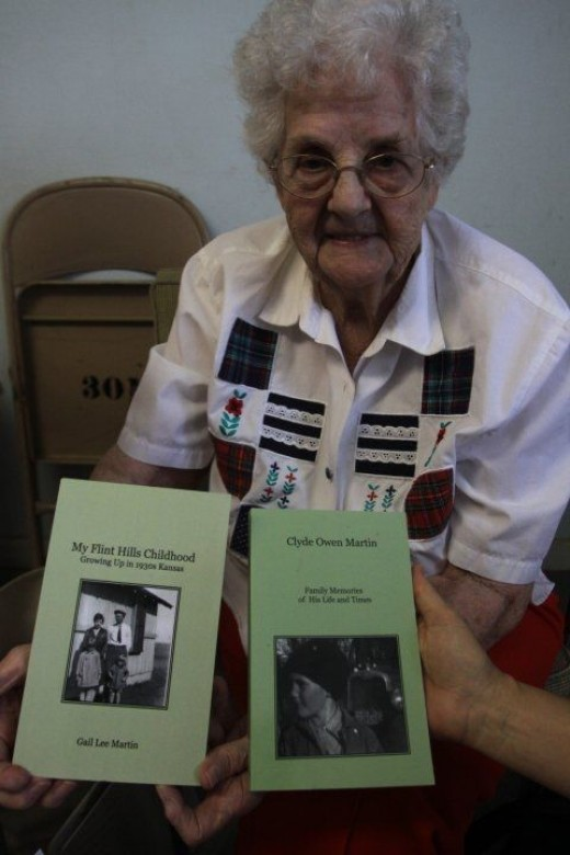 Gail Lee Martin with her two self-published books.