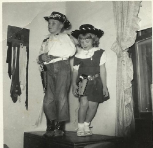 1950s children in cowboy costume