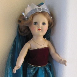 A Toni doll dressed as a princess. Her skirt and flowing train are made from a scarf.