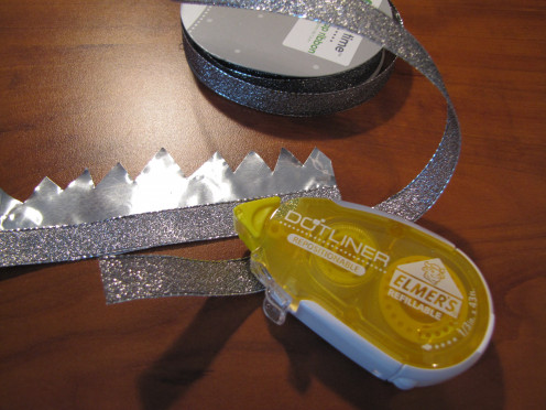 Adding the silver ribbon with double-stick tape.