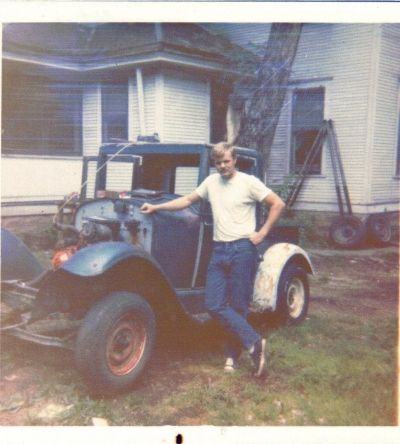 Owen Martin with the Essex Before Restoration. This was in his Butch Cassidy look-alike days. When he acquired the vintage car, it was in rough shape and needed some TLC.