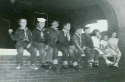 Owen Martin with his fellow boy scouts (and his sisters).