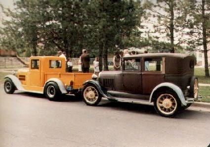 Owen's yellow 1927 Essex and his dad's 1928 Model A Ford