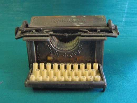 old metal mini typewriter in my sister's collection