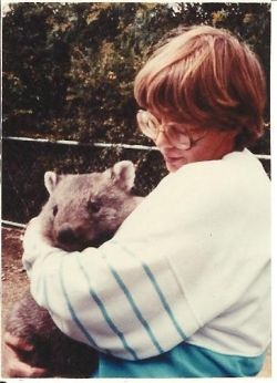 Here I am holding a wombat in Tasmania.