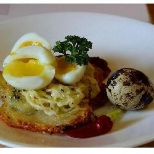 Potato galettes with quail eggs