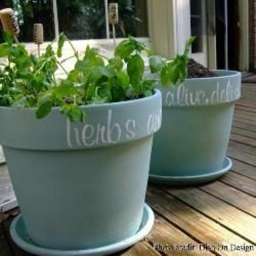 Terra cotta pots embellished with milk paint