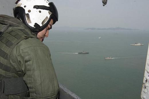 USMC Cpl Rogers in CH-53E (US Navy Photo/Christian Senyk)