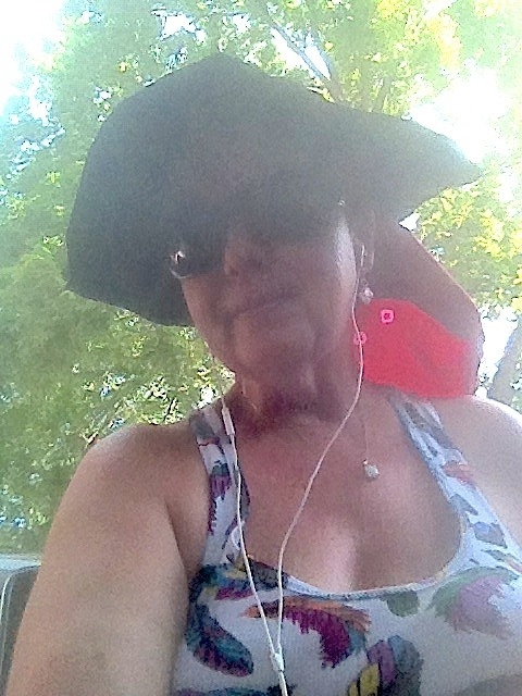 "The ""real me?"" Here it is! I'm wired, bluetoothed, sun protected, and off to garden! Around June 2012."