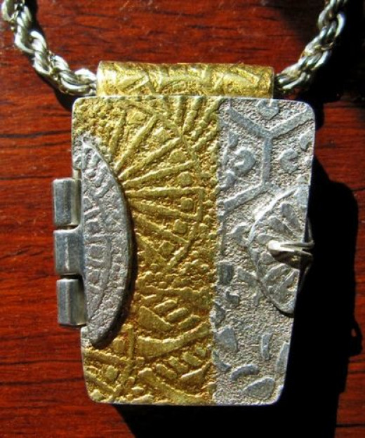 Fine silver PMC hinged box pendant with 24k gold keum-boo, designed and created by Margaret Schindel