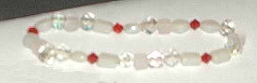 Very simple glass beads and crystals on elastic.