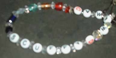 A memorial bracelet for my dog. Alphabet beads and glass beads on elastic.