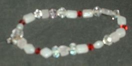Crystals and glass beads on elastic