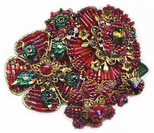 One-of-a-kind handcrafted brooch pin made with the cageworked beading technique popularized by Miriam Hagler, Robert DeMario and Ian St. Gielar