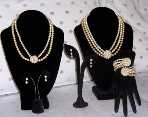 Coordinating pearl jewelry sets for the bride (right) and maid of honor (left). A custom commission.