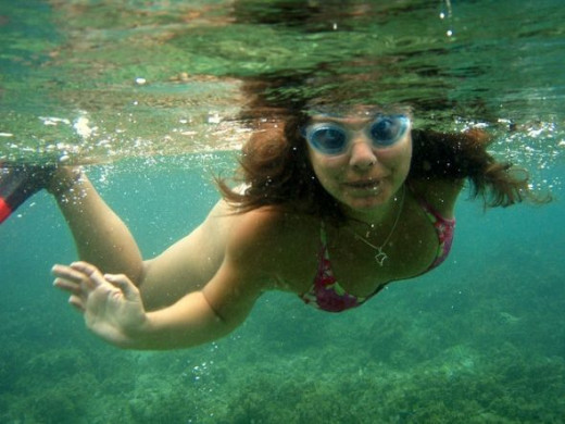 Underwater photo of a woman swimming