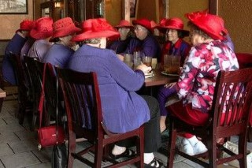 Ladies at a Red Hat Society meeting