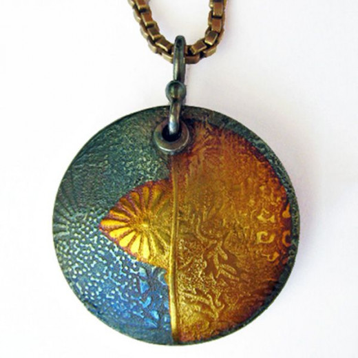 Fine silver pendant from PMC with liver of sulfur iridescent patina and 24k gold foil keum-boo accents