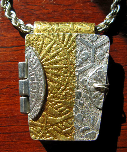 Fine silver locket pendant with 24k gold foil keum-boo accents. Constructed from fine silver metal clay textured with Asian-motif tear-away textures.