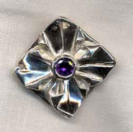 Photo: Fine silver metal clay origami brooch with an amethyst CZ set in a silver clay coil setting. Created and photographed by Margaret Schindel, all rights reserved.