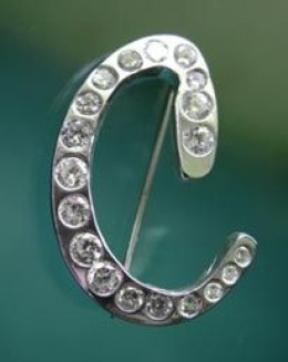 Photo: Fine silver C brooch with gypsy-set CZs, designed, created and photographed by Margaret Schindel, all rights reserved.