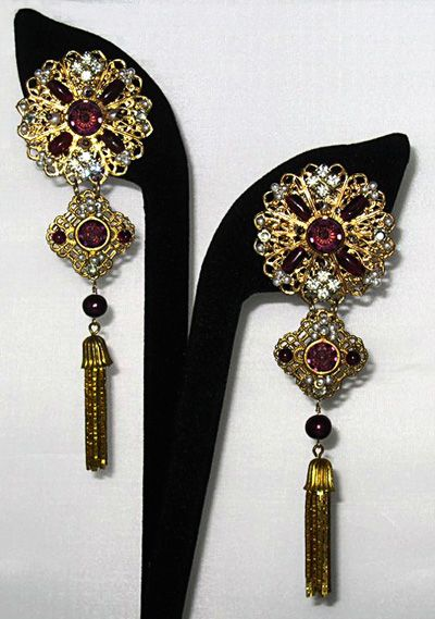 Fabulous shoulder duster earrings commissioned by a client for a fancy Washington, DC event. Garnets, pearls & rhinestones embroidered on filigrees.