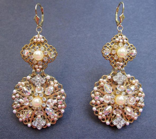 Sophisticated earrings commissioned by a mother of the bride. Hand embroidered pearls, seed pearls and Swarovski crystals on brass filigree stampings.