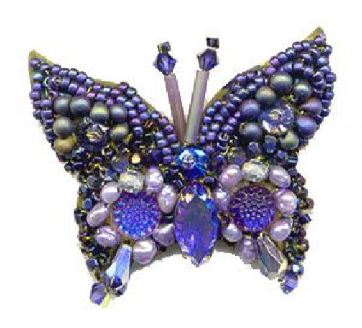 Bead embroidered butterfly pin features vintage crystal cabochons, vintage marquise crystal gemstone, glass beads and a vintage butterfly pin finding.