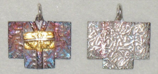 Front and back of a pair of fine silver metal clay kimono charms with patina and 24k gold keum-boo obi that I made into earrings for my sister.