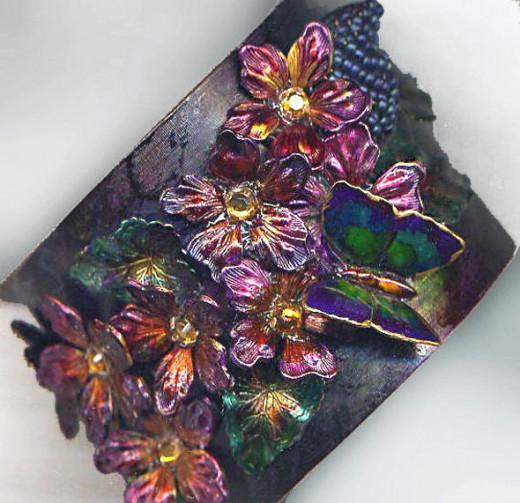 Hand painted, collaged brass cuff bracelet by Margaret Schindel