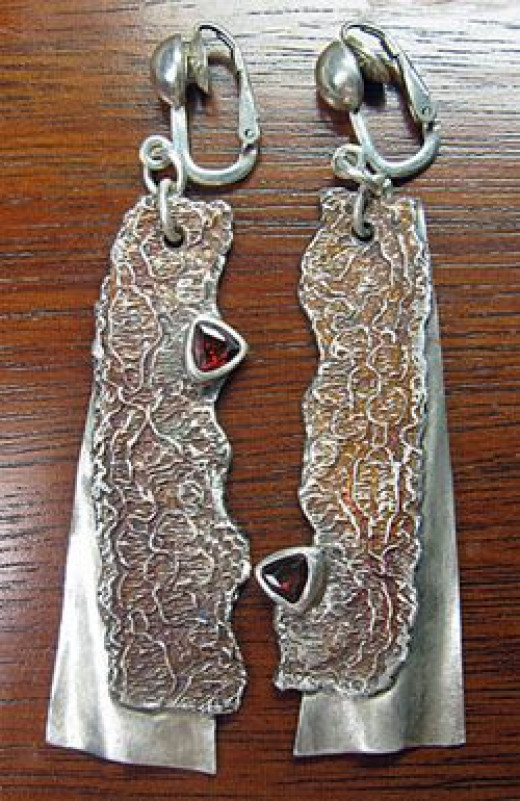 Asymmetrical lace textured fine silver earrings; metal clay with lab gemstones and iridescent liver of sulfur patina.