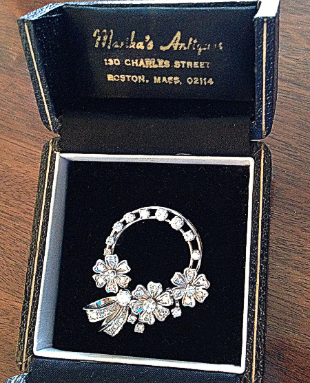An antique diamond and platinum circle brooch with three diamond flowers; two of which are spinners. A gift from Dad to Mom that I subsequently inherited.