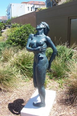 """According to Dr Alex Sandor Kolozsy, Sculptor - """"this sculpture depicts the human experience when the soul meets the creator"""". Made of cool cast bronze and timber."""