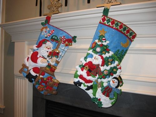 Handmade felt applique Christmas stockings made from popular Bucella kits.