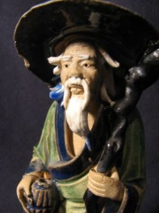 Antique Chinese Mud Man. Bought for $4. Sold for $380.