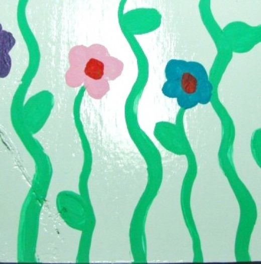 Paint wavy lines for stems and add a few leaves.