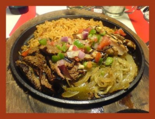 Steak Fajitas, as you'd see them in a restaurant, served on an iron skillet