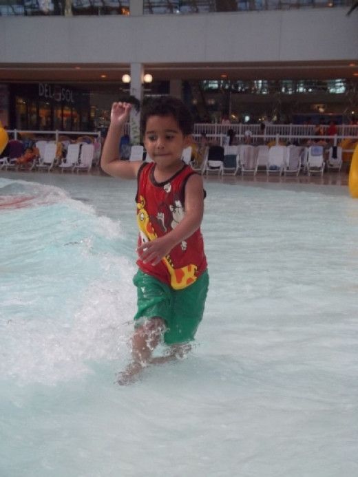 My son - enjoying the wave pool at the World's Largest Indoor Waterpark
