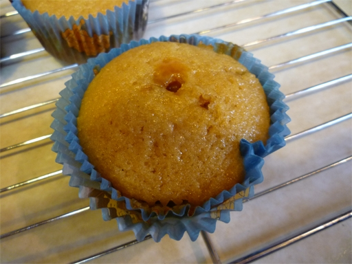 A filled cupcake. Insert the squeeze bottle into the top of the cupcake and gently squeeze until it starts to overflow.